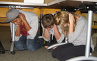 USC students drop, cover and hold on during a 2010 Great ShakeOut drill on the University Park campus. Photo by Shirley Shin.
