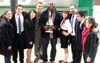 One of four USC Mock Trial Team squads claimed first place in the University of Pennsylvania's Quaker Classic Tournament in Philadelphia, Penn. Pictured from left to right: Gina Davidson, USC Mock Trial Team assistant coach; USC Dornsife freshmen David Nemeschansky, Courtney Chao, and Mitchell Diesko; Olu K. Orange, USC Mock Trial Team head coach; USC Dornsife junior Christen Philips; USC Dornsife sophomore Nerses Aposhian; USC Marshall School of Business freshman Kevin Fu and Lauren Herz, USC Mock Trial Team assistant coach.