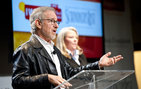 USC Trustee Steven Spielberg, who established the USC Shoah Foundation — The Institute for Visual History and Education in USC Dornsife nearly two decades ago, announces the IWitness Video Challenge at Chandler School in Pasadena, Calif. Kori Street, the institute's director of education, stands with Spielberg. Photo by Kim Fox.