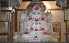 Adorned with sandalwood paste and roses, this white marble statue of a Jain Tirthankara, or Jina, an enlightened being who teaches Jainism, is from a temple in Bikaner, Rajasthan, Northwest India. Photo courtesy of James McHugh.