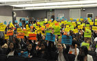 Two hundred local high school students hold aloft placards identifying the role of their assigned group at the 2013 High School Leadership Conference organized by the Center for Active Learning in International Studies (CALIS) housed in USC Dornsife. Photo by Susan Bell.