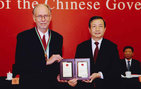 University Professor Michael Waterman with Chinese Vice Premier Ma Kai who awarded him the People's Republic of China Friendship Award at a ceremony held Sept. 29 in the Great Hall of the People at Tiananmen Square. The award is the Chinese government's highest honor for foreigners. Photo courtesy of the State Administration of Foreign Experts Affairs (SAFEA) of China.