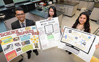 Arieh Warshel poster contest winners from left: 1st place, 11th grader Raqibul Mollah, 17; 2nd place, 9th grader Jin Yi Wu, 14 and 3rd place, 9th grader Alexandra Canjura, 14. They display their winning posters at Bravo Magnet High School on March 25, 2014. Photo by Gus Ruelas.
