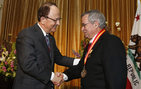 USC President C. L. Max Nikias congratulates Nobel laureate Arieh Warshel, Distinguished Professor of Chemisty, on Warshel's Presidential Medallion during the April 8 awards ceremony. Photo by Steve Cohn.