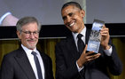 President Barack Obama holds up his Ambassador for Humanity Award, presented to him by USC Trustee Steven Spielberg, founder of USC Shoah Foundation — the Institute for Visual History and Education. Photos by Getty Images.