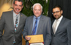 Professor Steven Lamy, vice dean for academic programs (center), accepts his USC Mellon Mentoring Award from Dean of Religious Life Varun Soni, chair of the USC Mellon Mentoring Forum (right), and professor Oliver Mayer, co-chair of the USC Mellon Mentoring Forum. Lamy was among 11 USC Dornsife faculty honored. Photo by Ziva Santop/Steve Cohn Photography.