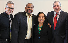 USC Dornsife professor Manuel Pastor (from left), talk show host Tavis Smiley; Maria Brenes, executive director of Inner City Struggle; and Jonathan Fielding, director of the Los Angeles County Department of Public Health, participated in Smiley's kickoff for a four-year initiative to address poverty in America. Photograph by Zon D'Amour.