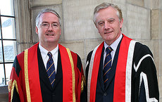 USC Dornsife's Donal Manahan (left), who served as chief scientist for many research expeditions to the Antarctic, has been awarded an honorary fellowship by Bangor University in Wales. Here, he stands with Bangor University Vice Chancellor John Hughes during the ceremony. Photo courtesy of Bangor University.