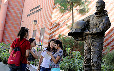 A freshman team in the USC GeoScavenge event find a clue at Neil Armstrong's statue. The event helped incoming students learn about the University Park campus. From left, Tayanna Todd, Molly Linder, Jennifer Wang and Sidrah Khan. Photos by Matt Meindl.