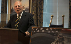 Former Secretary of the Navy Paul Ignatius speaks during the Washington, D.C., ship naming ceremony for the future <em>USS Paul Ignatius</em>. In the foreground is a representation of the ship. The alumnus will be inducted into the Half Century Trojans Hall of Fame. U.S. Navy photo by Mass Communication Specialist 1st Class Arif Patani.