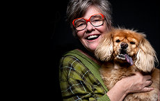 "Alumna, author and motivational speaker Barbara Jo ""BJ"" Gallagher is also an animal lover. Here, she holds her half Pekingese, half Chow, Fannie. Photo by Andy Stolarek."