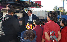 CBS Chief Meteorologist Josh Rubenstein demonstrates the weather predicting facilities at his mobile weather van to young participants in the Joint Educational Project's WonderKids program at 32nd Street School/USC Performing Arts Magnet. Photos by Susan Bell.