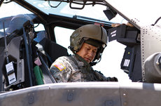 Alumnus Viet Luong, the first Vietnamese-born general officer in the United States military, seated in the cockpit of an AH-64D Apache Longbow attack helicopter assigned to the Air Cavalry Brigade at Fort Hood, Texas. Photos courtesy of the U.S. Army.