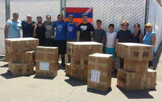 Tomik Vertanou (sixth from the left), stands with Hyer United volunteers. A shipment of medical supplies is ready for the two month trip to rural areas of Armenia. Photos courtesy Tomik Vertanous.
