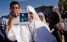 Self-proclaimed visionary Maria Paula Acuña holds a Polaroid photograph taken by a follower purporting to show proof of the presence of the Virgin Mary. Photo by Matt Gainer.