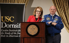 Former U.S. Representative Gabrielle Giffords stands alongside her husband, U.S. Navy Captain and astronaut Mark Kelly, while delivering the 14th Annual Carmen and Louis Warschaw Distinguished Lecture. Photos by Steve Cohn.
