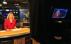 Alumna Alison Harmelin anchoring for CBS MoneyWatch in December 2014. Photos courtesy of Alison Harmelin.