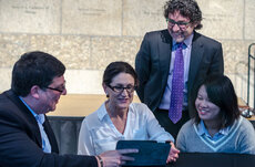 John Wilson (right) receives a certificate of accreditation for SSI's Graduate Certificate in Geospatial Intelligence Program from Keith Masback, CEO of the United States Geospatial Intelligence Foundation. Photo by Anne Marie Maltes.