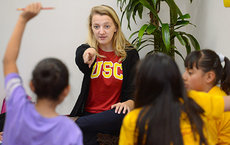 International relations major Meghan Jahnke works with elementary school pupils as part of a breakout session during the Penny Harvest Leadership Academy on March 10. Photo by Gus Ruelas.