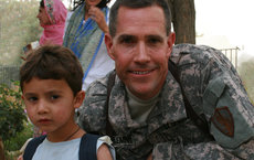 U.S. Army Colonel Steven D. Fleming, shown here at an orphanage he served during his deployment in Afghanistan, has joined USC Dornsife's Spatial Sciences Institute. Photos courtesy of Steven D. Fleming.