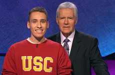 USC Dornsife student Sam Deutsch is pictured with Jeopardy! host Alex Trebek (Photo/Courtesy of Sony Entertainment)