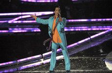 Prince performs an iconic set in pouring rain during half-time for Super Bowl XLI at Dolphin Stadium on February 4, 2007, in Miami. Photo by Anthony Correia.