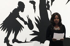At the poetry reading held before an invited audience at The Broad, doctoral student in creative writing and literature Mary-Alice Daniel reads aloud her poem written in response to California artist Kara Walker's work, <em>African't</em>. Photos by Susan Bell.