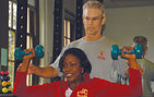 Department of Physical Education Director Steve VanKanegan and Administrative Assistant Amber Harris demonstrate proper weight training technique. Photo credit Taylor Foust.