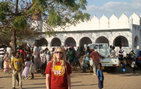"Wearing her USC T-shirt, Mary Ellen ""Jem"" Jebbia attends a coming-of-age celebration at a mosque during Ramadan in Malawi. Photo credit Karem Issa."