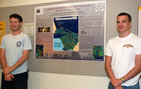 Kevin Kelly (left) and Ryan Drap, both seniors majoring in geography in USC College, stand next to their poster mapping out the air pollution levels near all roads in Los Angeles County. The poster and research won a top award by the Association of Pacific Coast Geographers. Students Austen Lee and Juan Morales were also on the winning team. The students had participated in the College's Summer Undergraduate Research Fund (SURF). Photo credit Taylor Foust.