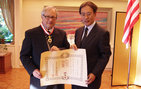Gordon Berger, USC College professor emeritus of history, receives the 2009 decoration of The Order of the Rising Sun from Junichi Ihara, consul general of Japan in Los Angeles.
