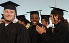 Kenechi Udeze (center) lines up to accept his bachelor's degree during the 2010 USC Student-Athlete Graduation Celebration held May 13 on University Park campus. Photo credit Pamela J. Johnson.