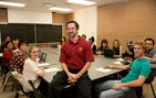 Students in a Writing 340 class taught by Mark Marino (center) have created @Wall Watch, a service project for victims of cyberbullying. Photo credit Jie Gu.
