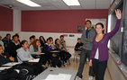 Lauren Slak, a senior majoring in international relations and creative writing in USC College, teaches ethics to Manual Arts Senior High School students, with Richard Sidhom, a philosophy freshmen in the College. Photo credit Pamela J. Johnson.