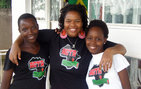 "Divinity Matovu '08 (middle) with young women from the Amagezi Gemaanyi Youth Association (AGYA) in Uganda, which she co-founded in 2008. <em>Glamour</em> magazine has named Matovu one of ""20 Amazing Young Women Who Are Already Changing the World."" Photo courtesy Divinity Matovu."