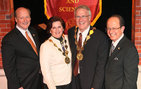 Dana and David Dornsife (center), who received the University Medallion for their historic gift, celebrate with Howard Gillman (left), dean of the newly named USC Dana and David Dornsife College of Letters, Arts and Sciences, and USC President C. L. Max Nikias (right). Photo by Phil Channing.