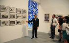 "MOCA Director Jeffrey Deitch (left) gives a tour of ""Art in the Streets"" recently to Richard Meyer, associate professor of art history in USC Dornsife (middle in black tie) and his undergraduate students in his course, ""Culture Wars: Art and Social Conflict, 1900 — the present."" Photo by Michelle Salzman."