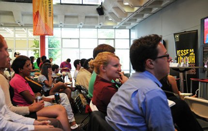 Victoria Hallebo (middle, red shirt) watches closely as the GOP presidential candidates discuss energy, Social Security, jobs and more. Hallebo, a political science and cinematic arts major, is vice president of USC College Democrats. Photo by Michelle Salzman.