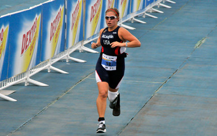 Danielle McLaughlin, a USC Dornsife staff member working in the School of International Relations, heads for the finish line during the International Triathlon Union Championship Series Beijing Grand Final in which she won a gold medal. Photo courtesy of the International Triathlon Union.