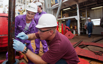 USC Dornsife's Katrina Edwards, left, examines a sample during a deep-sea expedition. Photo by Bill Crawford.