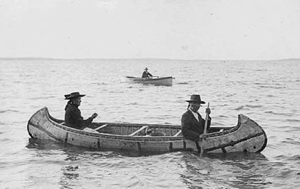 Ojibwe indians in Minnesota use a birch bark canoe for transport circa 1910. USC Dornsife's David Treuer fuses historical facts, reportage and memoir in his new book <em>Rez Life</em> to give a detailed history of Indian reservations in the U.S. Photo courtesy of the Minnesota Historical Center.