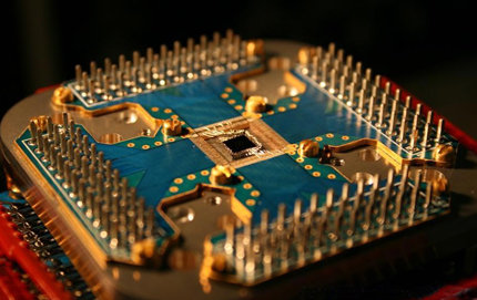 Quantum computers use quantum bits, or qubits, which can encode a one and a zero at the same time. Photo courtesy of D-Wave Systems Inc.