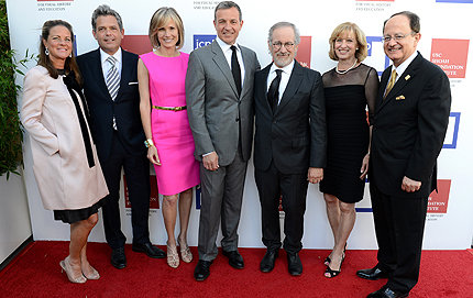 Robert A. Iger, chairman and CEO of The Walt Disney Company (center), earns the USC Shoah Foundation Institute's highest honor, the Ambassador for Humanity Award. From left, Berit Francis, Michael Francis, Willow Bay, Iger, Steven Spielberg, Niki Nikias and C. L. Max Nikias. Photo by Michael Kovac/Getty Images.