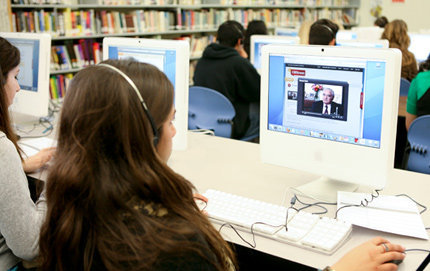 A high school student watches Holocaust survivor Roman Kent's testimony about his experience in Poland during World War II on IWitness. The educational resource provides educators and students with more than 1,000 video testimonies of eyewitnesses of the Holocaust to be used in classroom lessons. Photo by Melissa Jacobs.