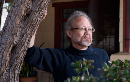 David St. John is the author of 10 collections of poetry, the newest is <em>The Auroras</em> (HarperCollins, 2012). Here, St. John of USC Dornsife stands in front of his home in Venice, Calif. Photo by Roger Snider.