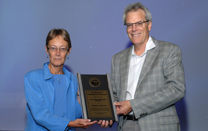 USC Dornsife's Michael Messner receives the 2012 Jessie Bernard Award from Judith Howard, professor and divisional dean of social sciences at the University of Washington's College of Arts & Sciences, during a ceremony in Denver, Colo. Photo courtesy of the American Sociological Association.