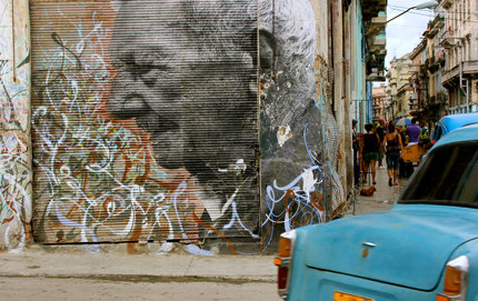 "This street art located near Callejón de Hamel in Havana is part of the photographer/graffiti artist known as JR's ""Wrinkles in Time"" project featuring images of elders from the region. In Cuba, there is a disproportionate amount of elderly as a result of migration and low birth rates. Photo by Karen Graciela Calderon."