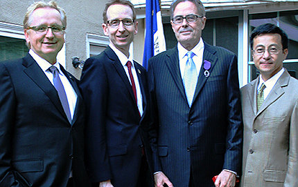 Charles McKenna, professor of chemistry and vice dean for natural sciences in USC Dornsife (third from left), wears his decoration recognizing him as a <em>Chevalier</em> (Knight) in the <em>Ordre des Palmes Académiques</em> (Order of Academic Palms), with (from left) incoming USC Dornsife Dean Steve Kay; USC Executive Vice Provost Michael Quick; and Chi Mak, professor and chair of chemistry in USC Dornsife. Photo courtesy of the Consulate General of France in Los Angeles.