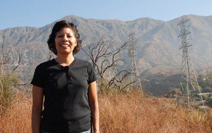 USC Dornsife's Laura Pulido stands near the gravesite of Owen Brown in the hills of Altadena, Calif., one of the sites in her new guidebook, <em>A People's Guide to Los Angeles</em>. Photo by Laura Paisley.