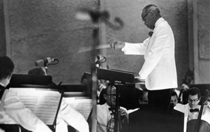 William Grant Still conducting the Los Angeles Philharmonic at the Hollywood Bowl in a piece titled <em>Old California</em> that he wrote for the city of Los Angeles' Birthday Concert on Sept. 8, 1965. All photos courtesy of Judith Anne Still.
